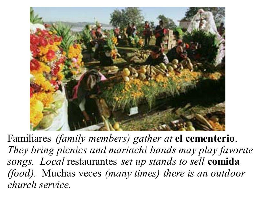 En el cementerio Familiares (family members) gather at el cementerio.