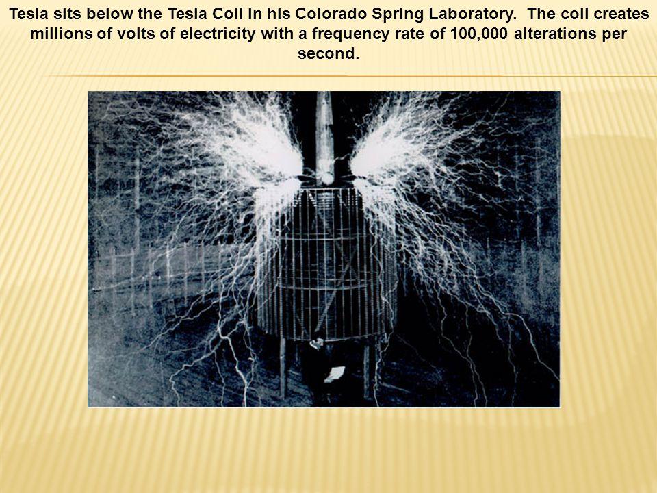 Tesla sits below the Tesla Coil in his Colorado Spring Laboratory.
