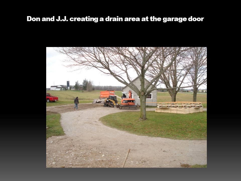 Don and J.J. creating a drain area at the garage door