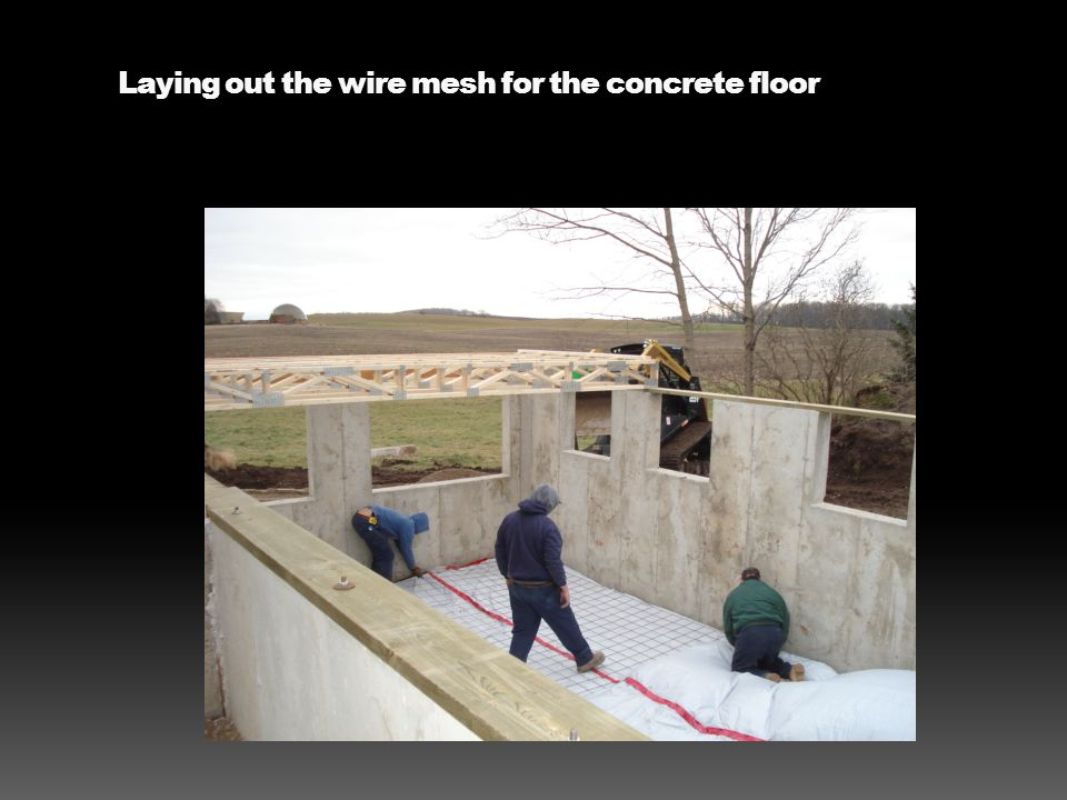 Laying out the wire mesh for the concrete floor