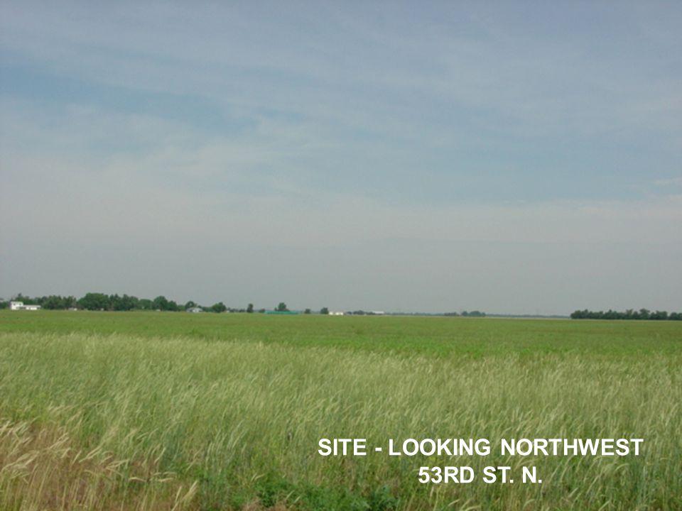 SITE - LOOKING NORTHWEST 53RD ST. N.