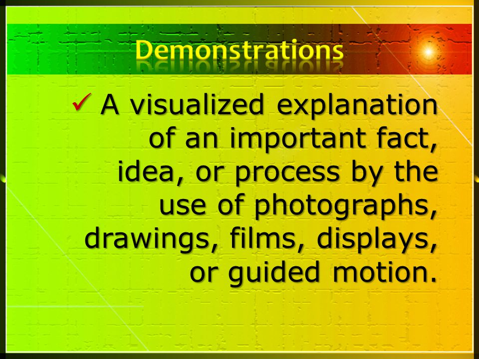 A visualized explanation of an important fact, idea, or process by the use of photographs, drawings, films, displays, or guided motion.