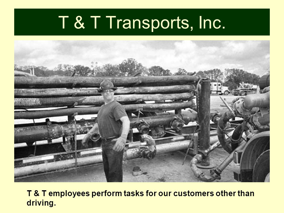 T & T Transports, Inc. T & T employees help prepare a location for a job.