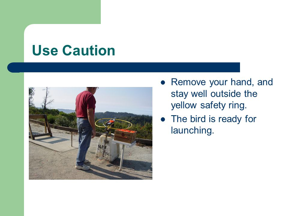 Use Caution Remove your hand, and stay well outside the yellow safety ring.
