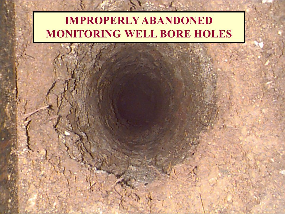 4 FOOT DIAMETER BRICK WELL ENLARGES TO 5-6 FEET DIAMETER, TEN FEET BELOW GRADE WATER VISIBLE AT 20 FEET