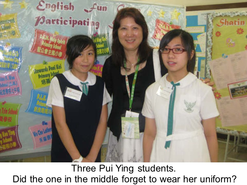 Three Pui Ying students. Did the one in the middle forget to wear her uniform?