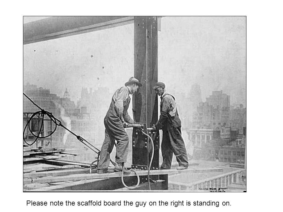 Please note the scaffold board the guy on the right is standing on.