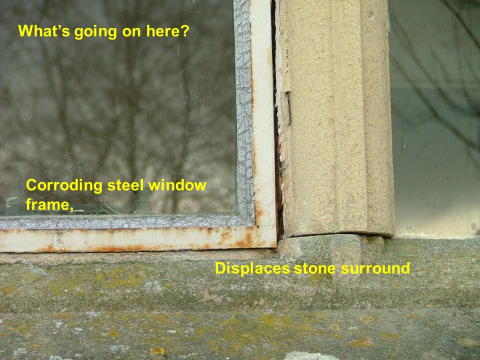 What's going on here Corroding steel window frame, Displaces stone surround