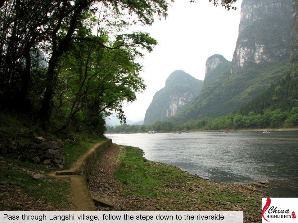 Pass through Langshi village, follow the steps down to the riverside
