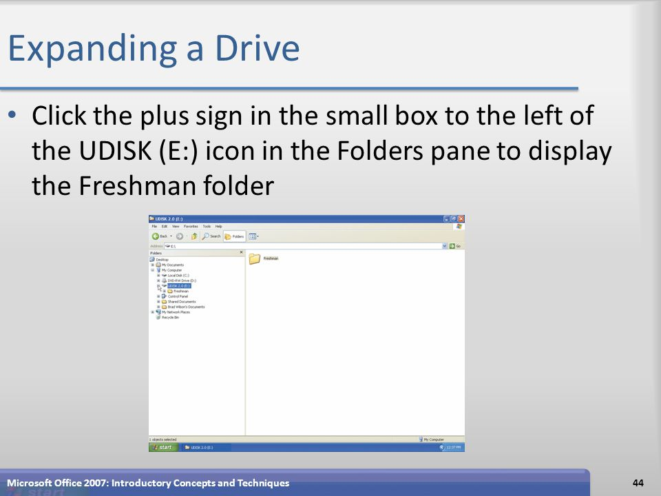 Expanding a Drive Click the plus sign in the small box to the left of the UDISK (E:) icon in the Folders pane to display the Freshman folder Microsoft