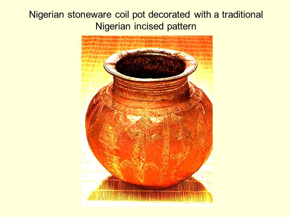 Unglazed earthenware jar decorated with darker slip.