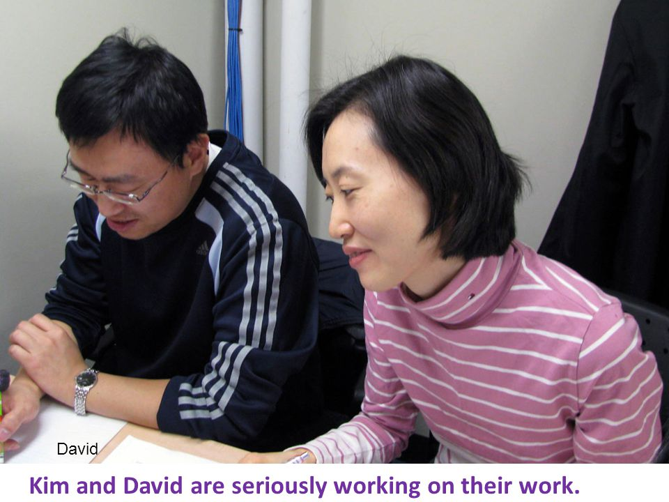 Kim and David are seriously working on their work. David