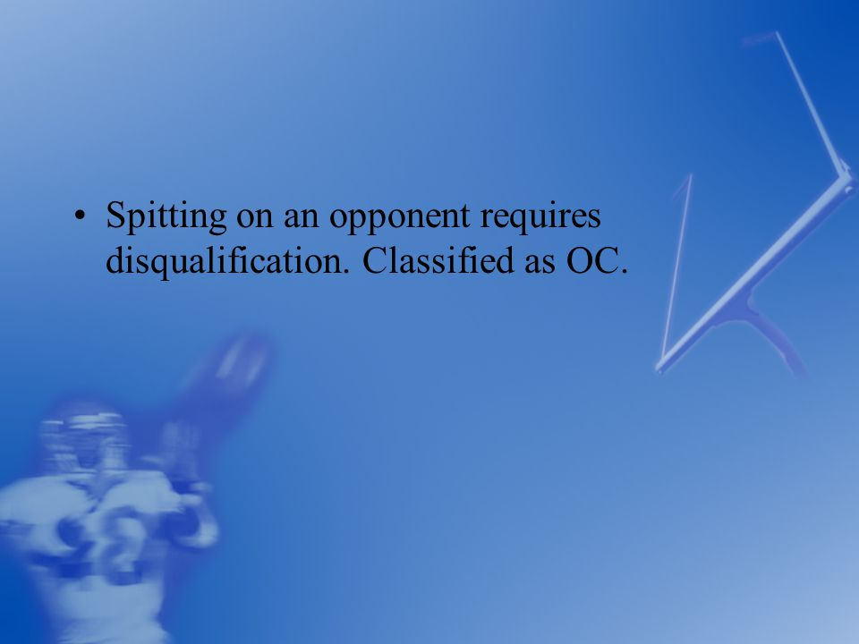 Spitting on an opponent requires disqualification. Classified as OC.