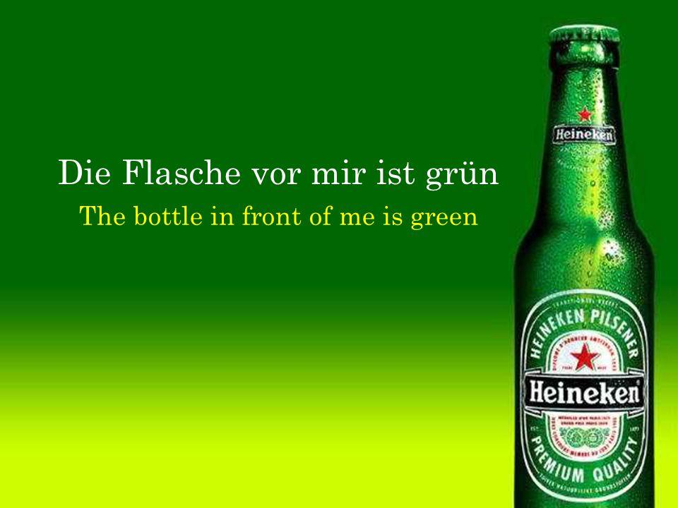 Die Flasche vor mir ist grün The bottle in front of me is green