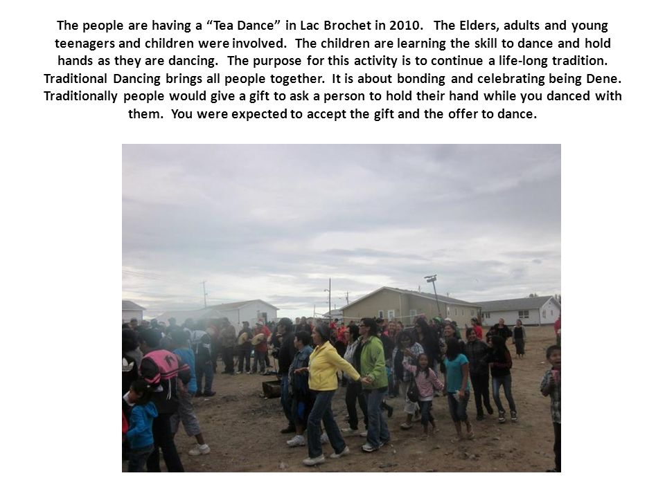 "The people are having a ""Tea Dance"" in Lac Brochet in 2010. The Elders, adults and young teenagers and children were involved. The children are learni"