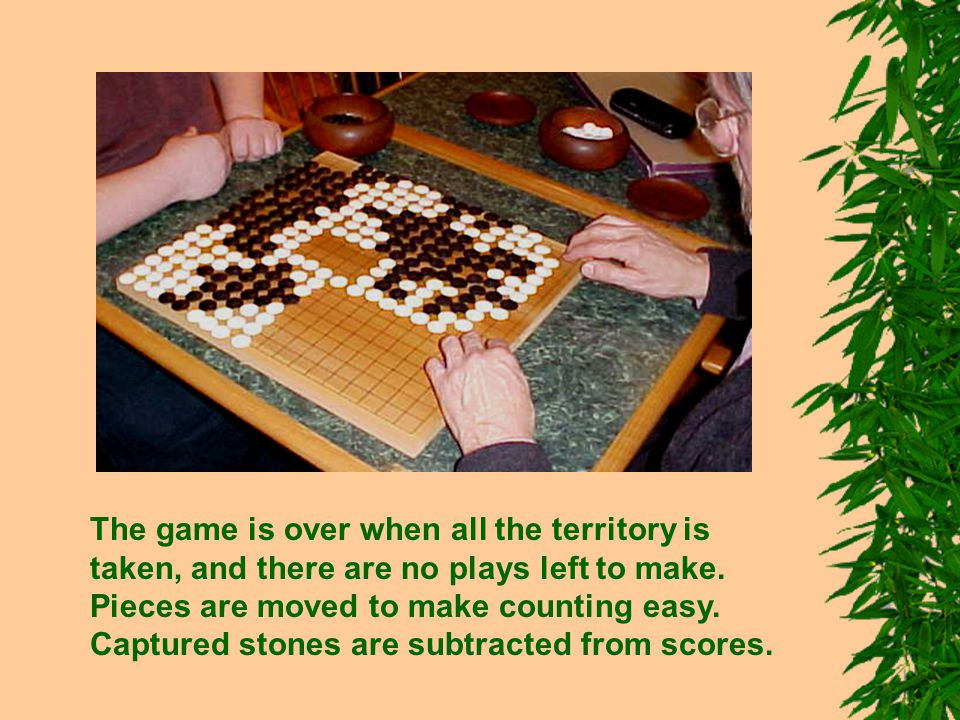 The game is over when all the territory is taken, and there are no plays left to make. Pieces are moved to make counting easy. Captured stones are sub