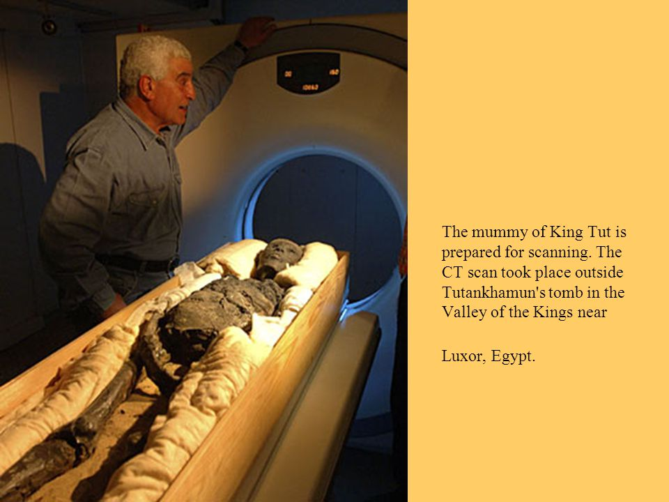 The mummy of King Tut is prepared for scanning.