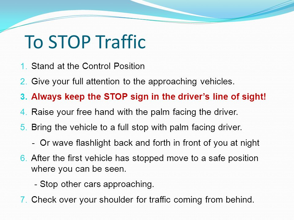 To STOP Traffic 1. Stand at the Control Position 2.