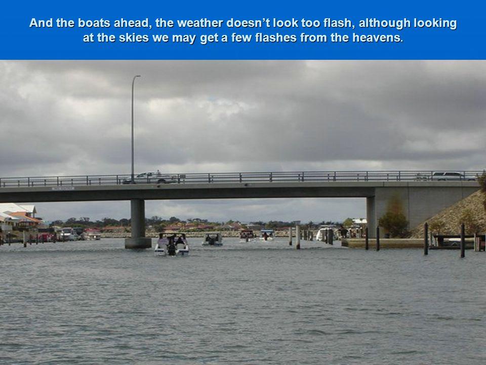 The fleet pass under the Bunbury bypass bridge.