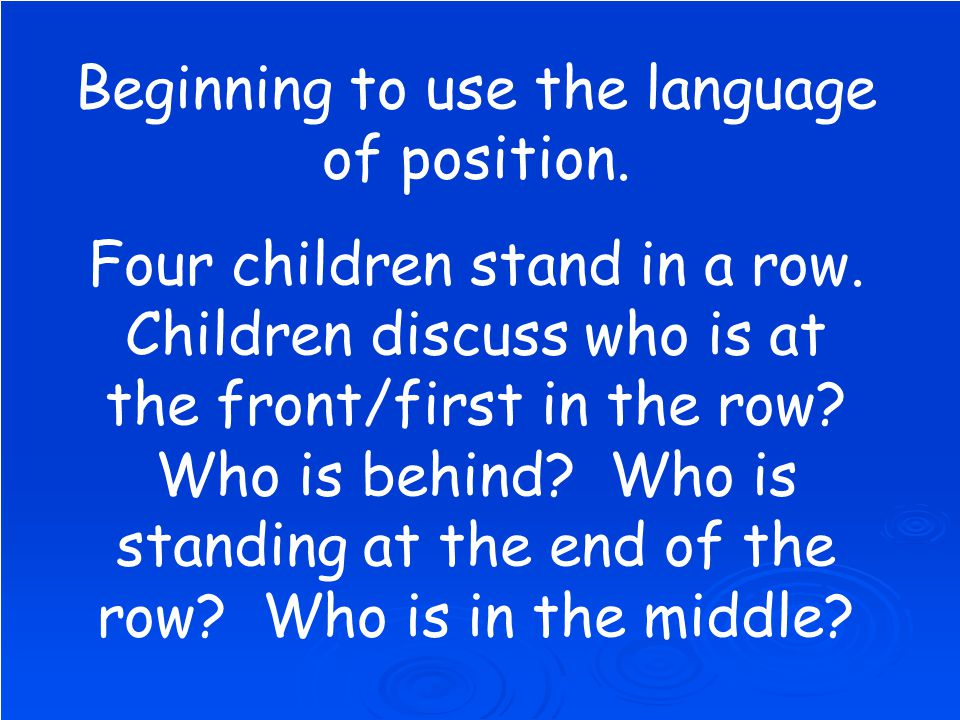 Beginning to use the language of position. Four children stand in a row.