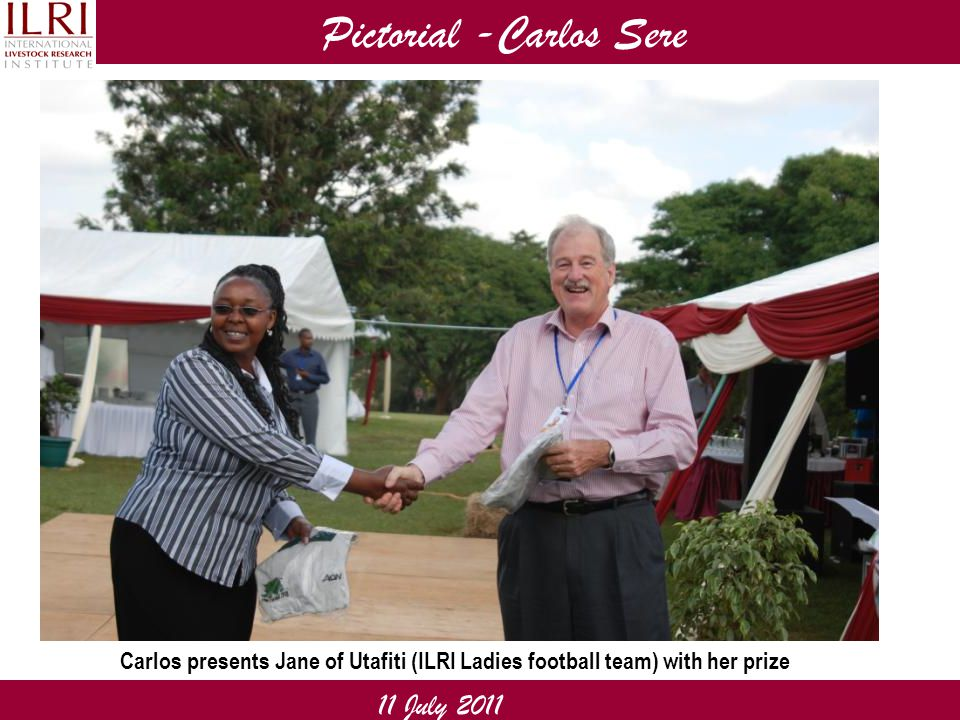 Pictorial -Carlos Sere 11 July 2011 Carlos presents Jane of Utafiti (ILRI Ladies football team) with her prize