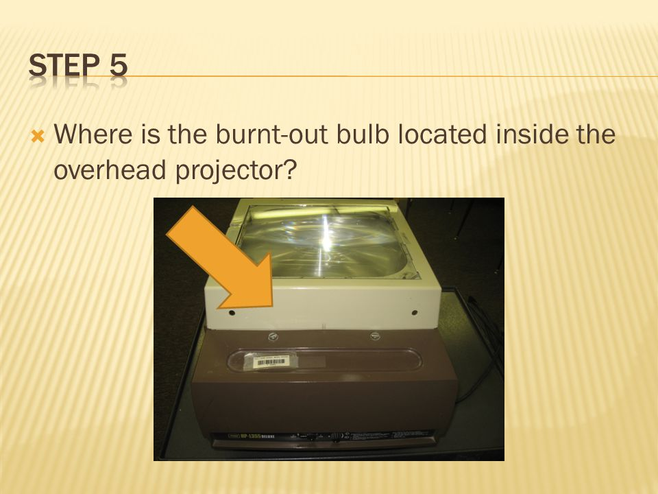  Where is the burnt-out bulb located inside the overhead projector