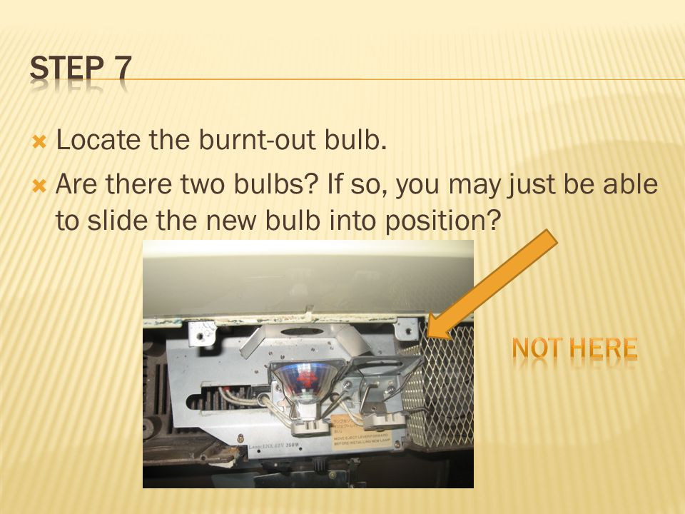  Find the metal bar on the right side of the bulb.  Press down gently.