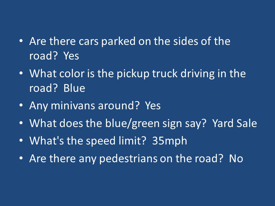 Are there cars parked on the sides of the road.