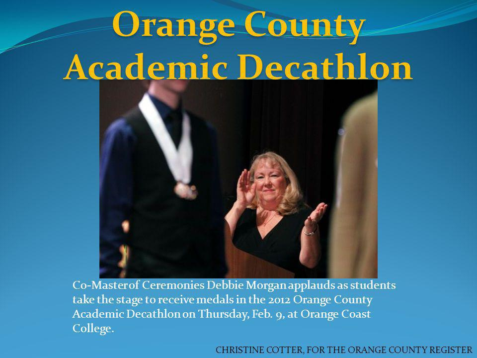 Orange County Academic Decathlon CHRISTINE COTTER, FOR THE ORANGE COUNTY REGISTER Co-Master of Ceremonies Debbie Morgan applauds as students take the stage to receive medals in the 2012 Orange County Academic Decathlon on Thursday, Feb.