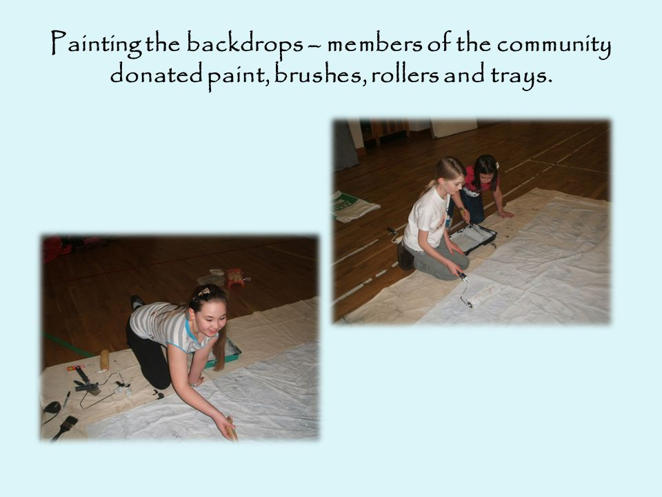 Painting the backdrops – members of the community donated paint, brushes, rollers and trays.