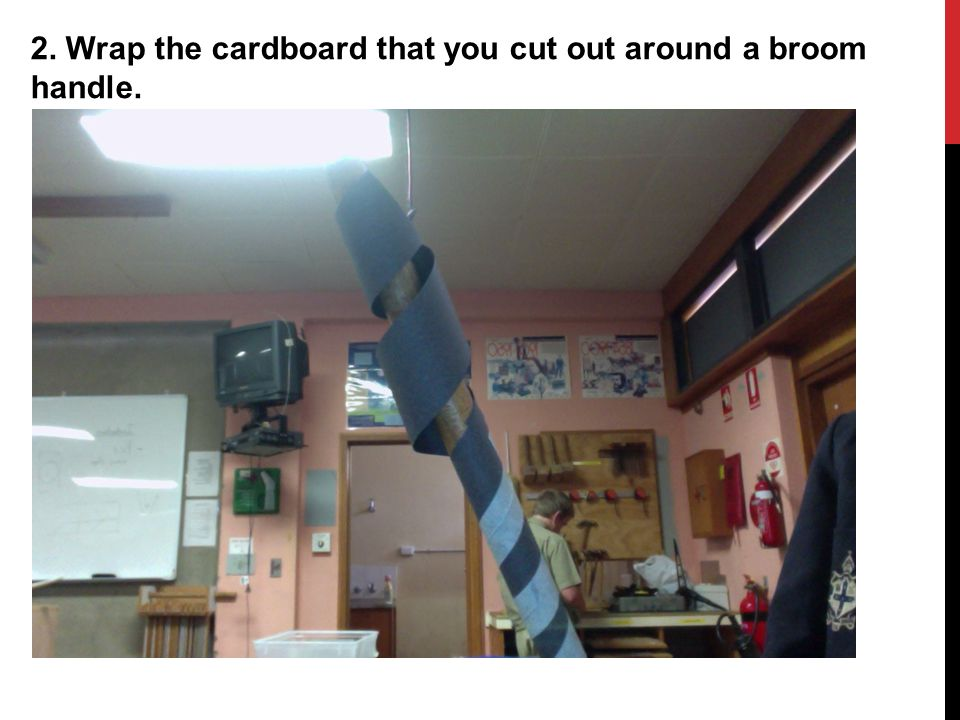 2. Wrap the cardboard that you cut out around a broom handle.