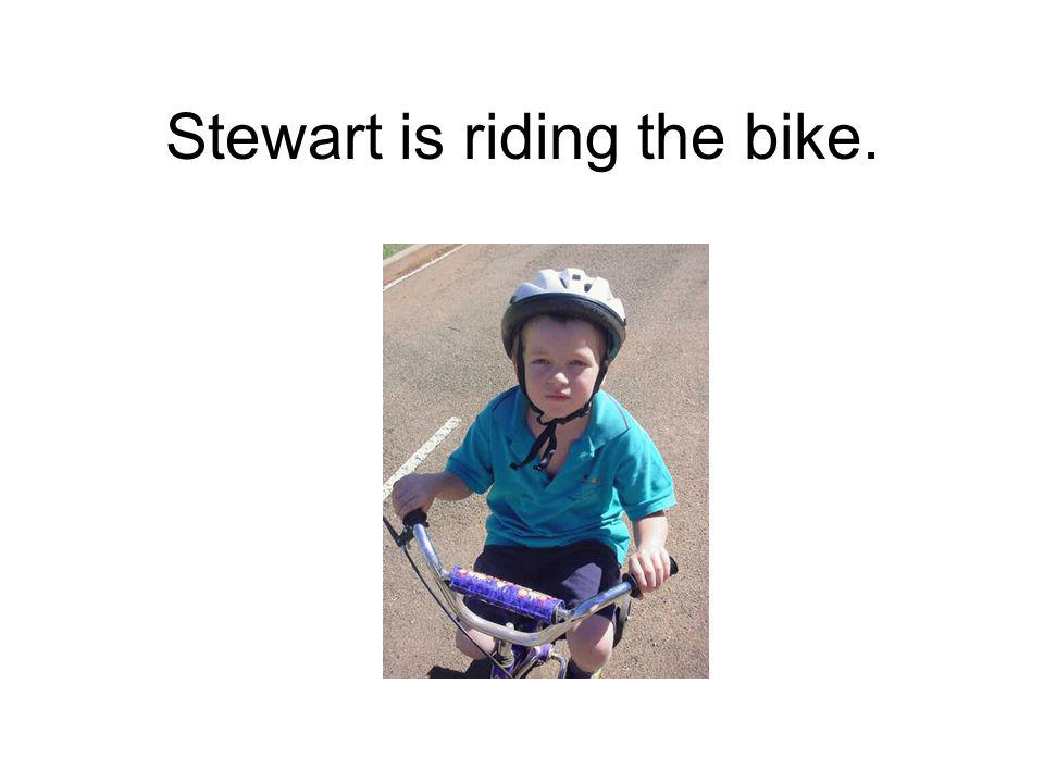 Stewart is riding the bike.