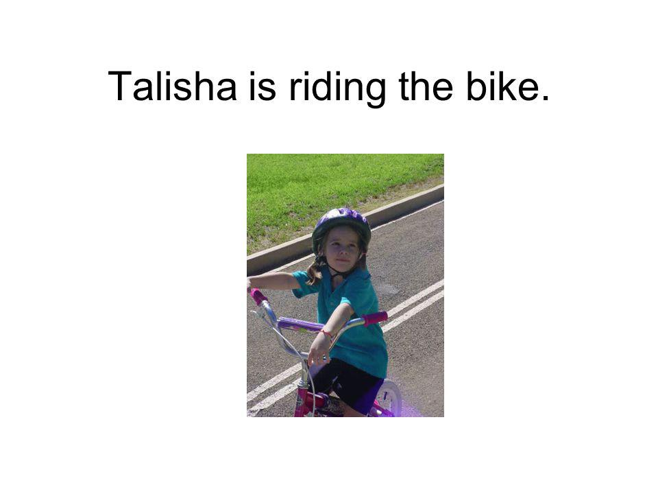 Talisha is riding the bike.