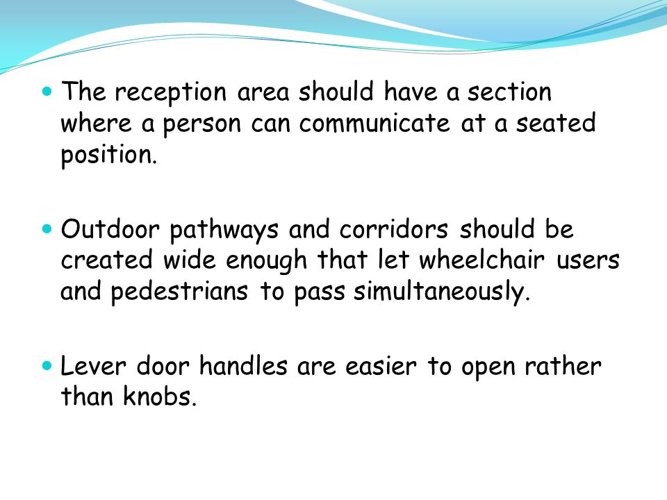 The reception area should have a section where a person can communicate at a seated position.