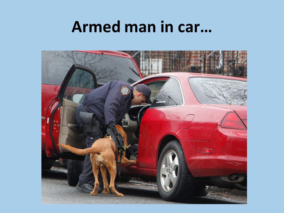 Armed man in car…