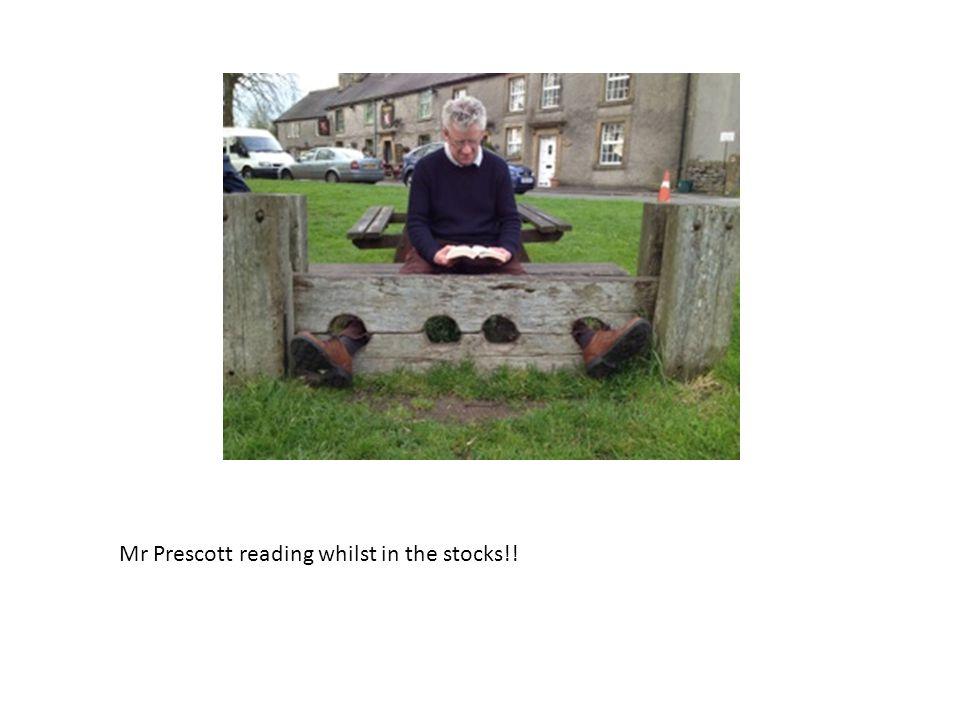 Mr Prescott reading whilst in the stocks!!