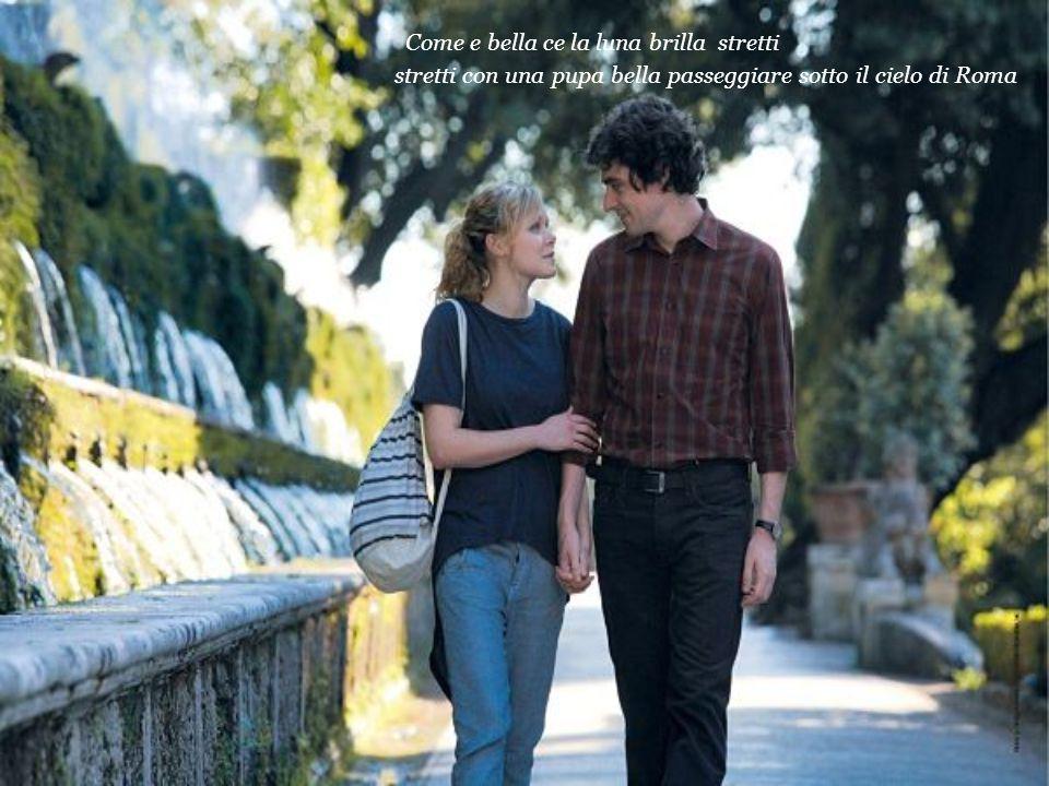 Come e bella ce la luna brilla stretti stretti con una pupa bella passeggiare sotto il cielo di Roma