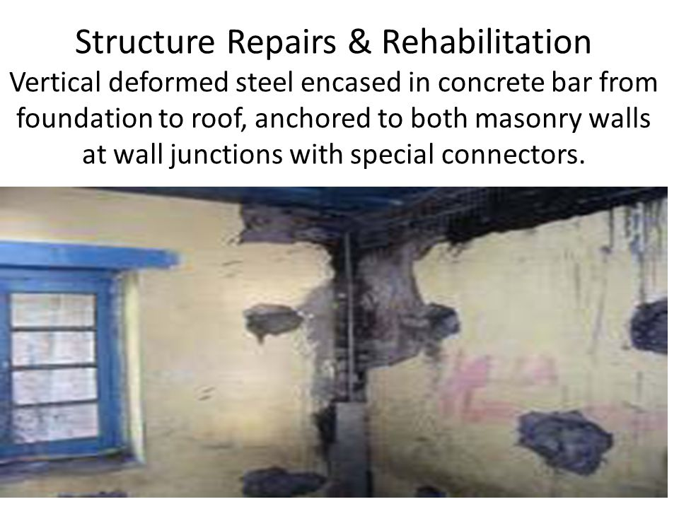 Structure Repairs & Rehabilitation Vertical deformed steel encased in concrete bar from foundation to roof, anchored to both masonry walls at wall jun