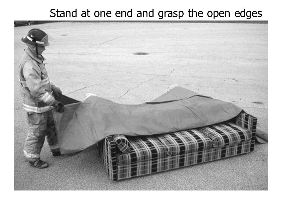 Stand at one end and grasp the open edges