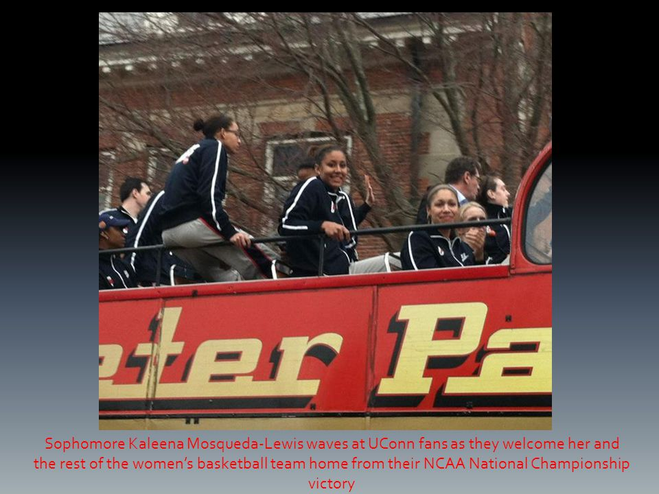 Sophomore Kaleena Mosqueda-Lewis waves at UConn fans as they welcome her and the rest of the women's basketball team home from their NCAA National Championship victory