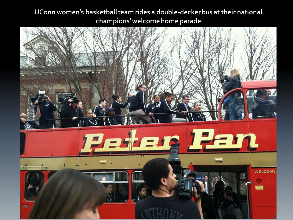 UConn women's basketball team rides a double-decker bus at their national champions' welcome home parade