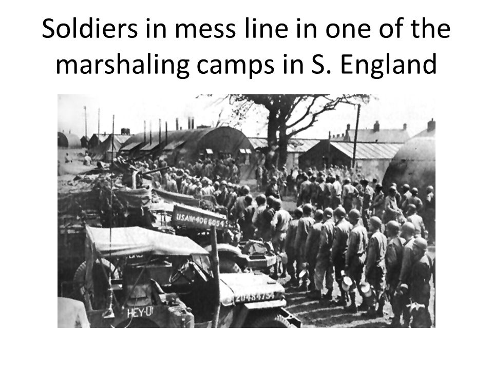 Soldiers in mess line in one of the marshaling camps in S. England