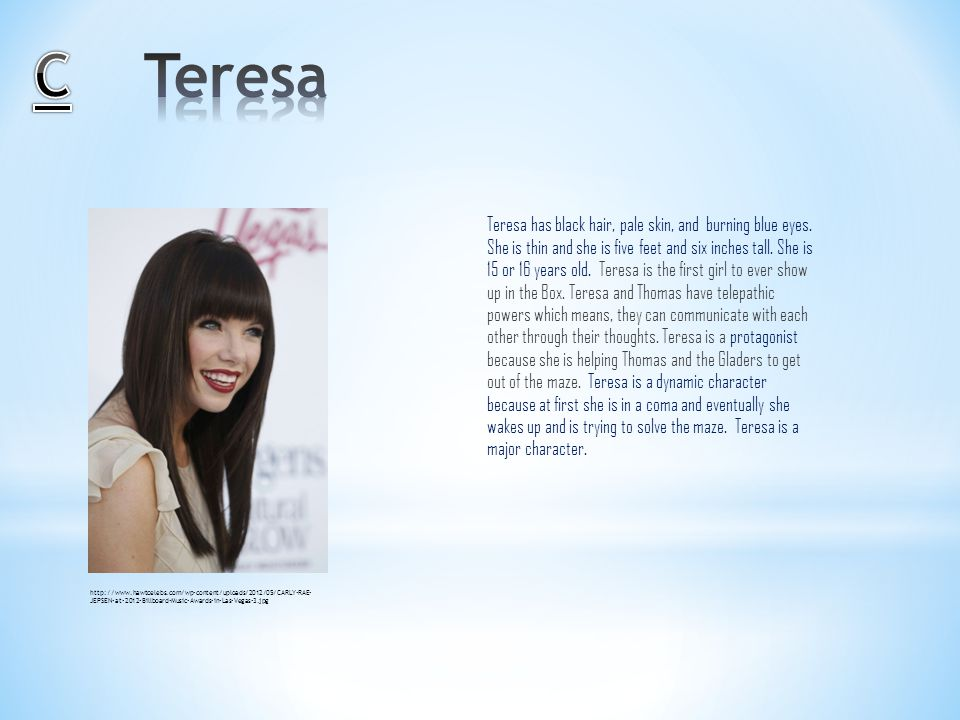 Teresa has black hair, pale skin, and burning blue eyes.
