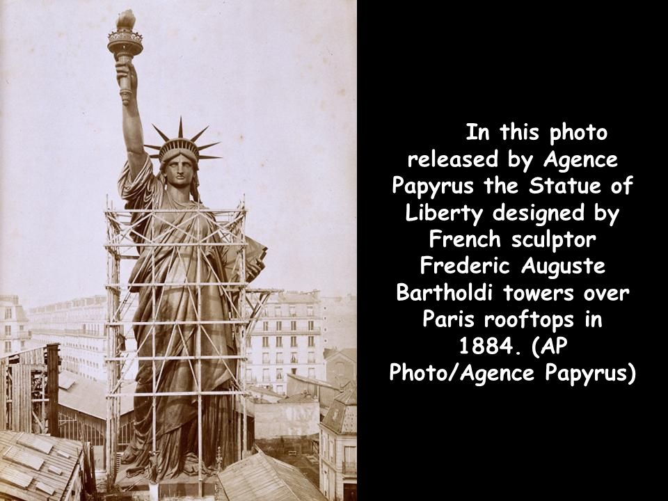 In this photo released by Agence Papyrus the Statue of Liberty designed by French sculptor Frederic Auguste Bartholdi towers over Paris rooftops in 1884.
