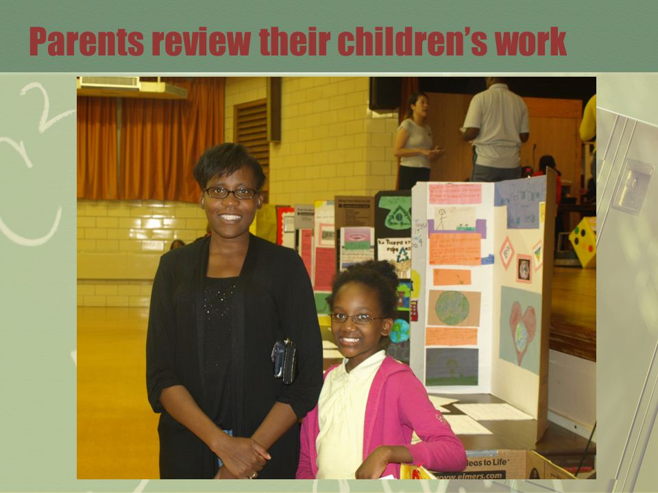Parents review their children's work