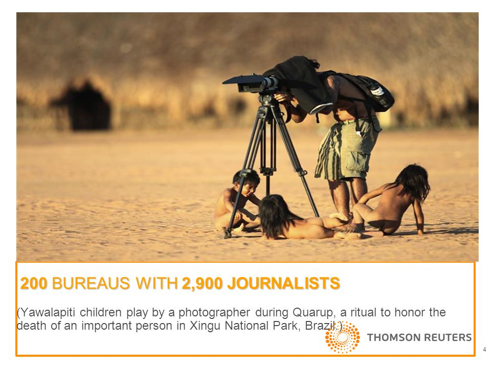200 BUREAUS WITH 2,900 JOURNALISTS (Yawalapiti children play by a photographer during Quarup, a ritual to honor the death of an important person in Xingu National Park, Brazil.) 4