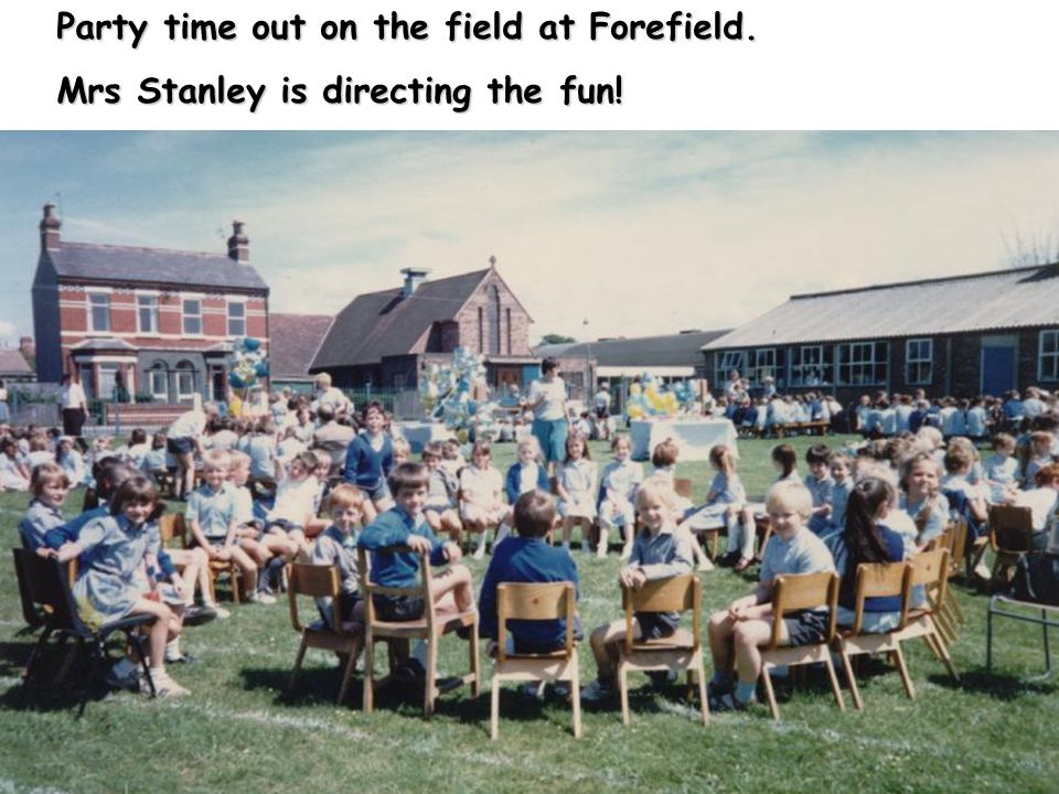 Party time out on the field at Forefield. Mrs Stanley is directing the fun!