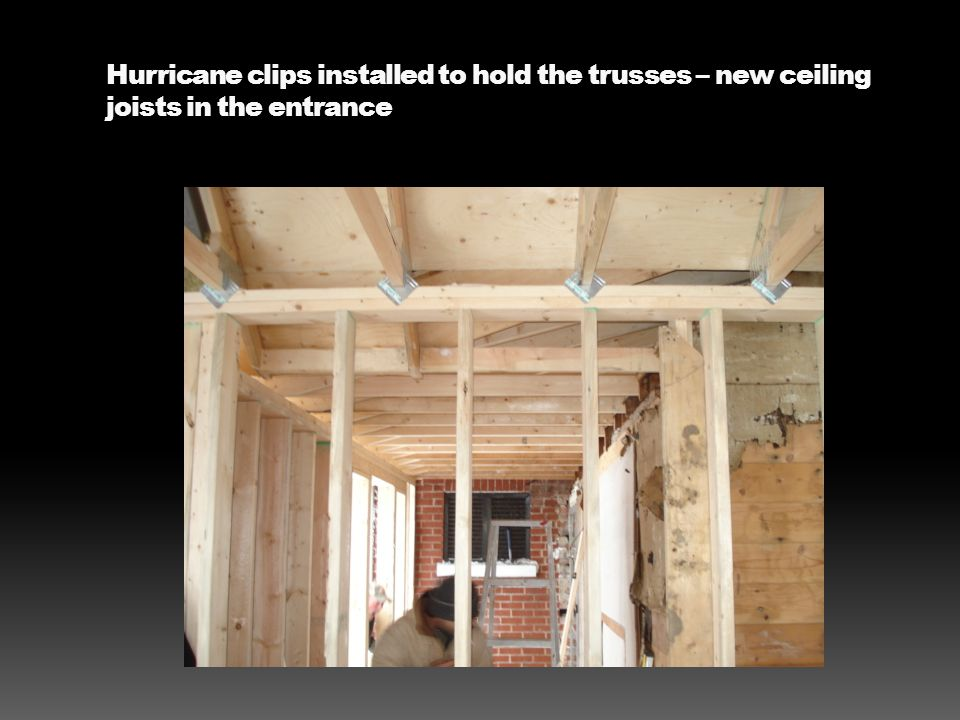 Hurricane clips installed to hold the trusses – new ceiling joists in the entrance