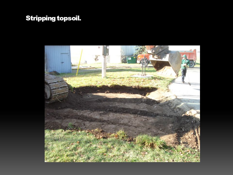 Stripping topsoil.