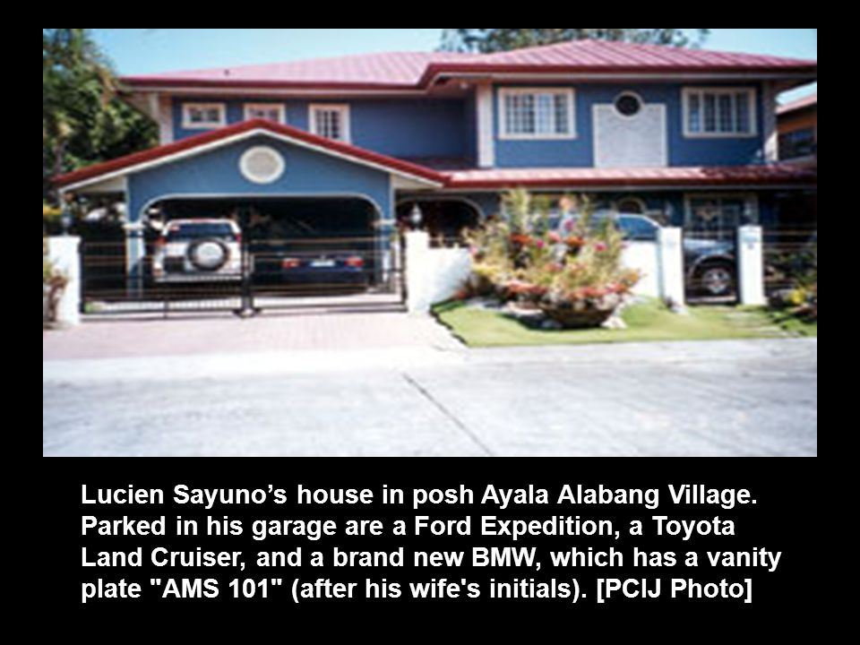 Lucien Sayuno's house in posh Ayala Alabang Village. Parked in his garage are a Ford Expedition, a Toyota Land Cruiser, and a brand new BMW, which has